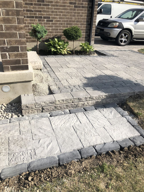 Interlocking paver walkway w. border. A paver walkway project by O'Connor Stone & Landscape.
