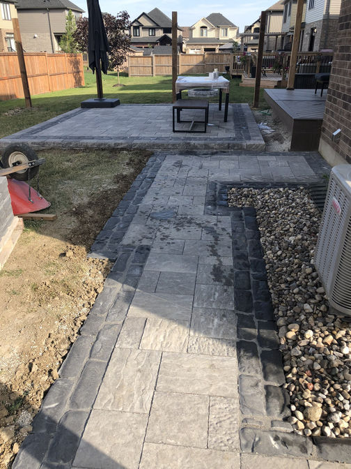 Paver walkway with border and patio. A paver walkway project in London Ontario region by O'Connor Stone & Landscape
