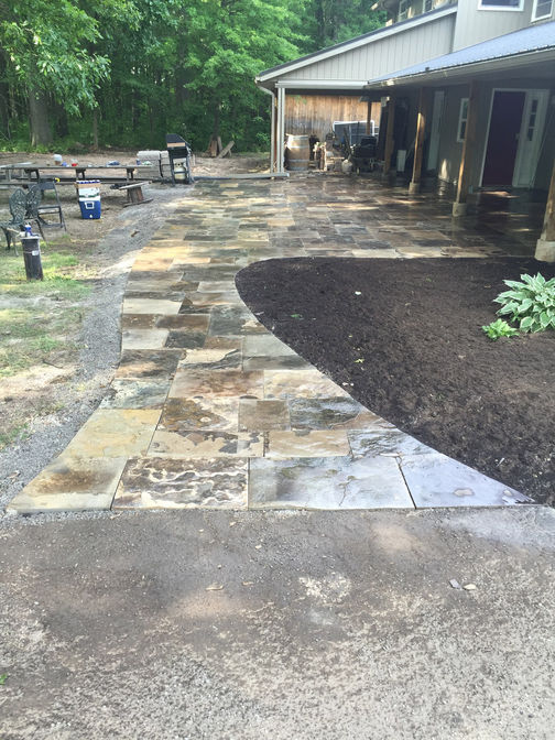 Square cut flagstone walkway and patio. A stone walkway project in London Ontario region by O'Connor Stone & Landscape.