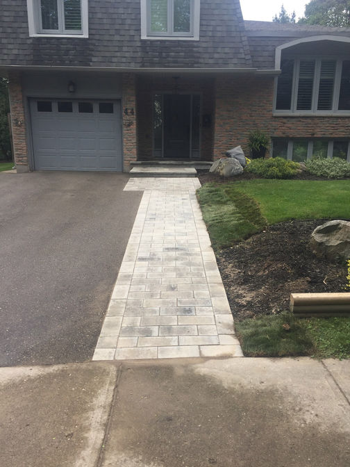 Paver walkway / driveway extension. A paver walkway project in London Ontario region by O'Connor Stone & Landscape.
